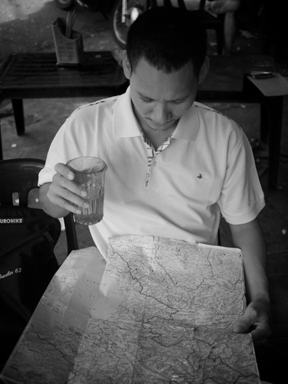 black and white image of vietnamese man with map