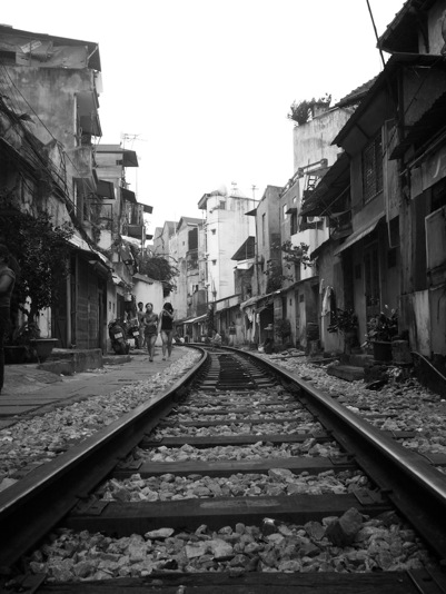 B&W Hanoi street scene of railway and houses