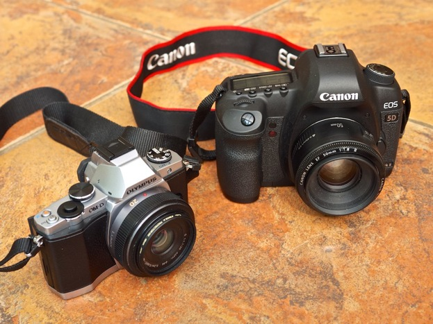 Olympus OM-D E-M5 beside a Canon 5D Mkii showing the difference in size